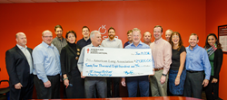 Kelser President & CEO Barry Kelly (R) along with Kelser employees present the record breaking check to Jeff Seyler (L) President & CEO, American Lung Association of the Northeast