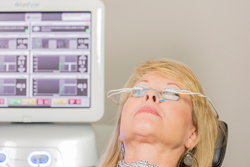 A woman with the LipiFlow® treatment device, The Activator, placed over her eyes