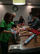 Clickstop employees help wrap Christmas presents for 19 area families.