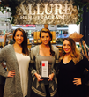 Allure Home Fragrance Ladies with the winning trophy