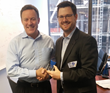 Booker SVP of Marketing Jim D'Arcangelo (L) accepting his 2016 BIG Innovation Award from Business Intelligence Group Managing Director Russ Fordyce (L) in New York City