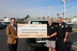 Chief of Police Robert Handy accepting a check from Huntington Beach Chrysler Dodge Jeep Ram