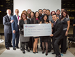 Surrounded by local agents and representatives, Jacqueline Camacho-Ruiz,  center, accepts this $10,000 check from Farmers Insurance during the Fig  Factor Foundation Official Launch and Fundraiser.