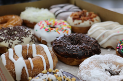 One dozen Duck Donuts donuts.