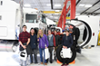 High school students pose in front of a truck at a press conference to announce the new Utah Diesel Technician Pathways program.