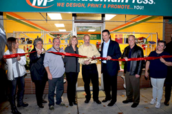 Accompanied by friends, family and clients, Alan Schneider cuts the ceremonial ribbon as he celebrates the move of his Minuteman Press franchise in Northvale, NJ to its brand new location at 202 Livingston Street