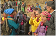 Volunteer Ministers (in yellow) present winter clothing and warm blankets to villagers in Aaru Pokhari, where nearly every one of the 240 households and the village schools suffered severe earthquake damage in the April 2015 earthquake.
