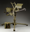 "Lot 2682, an impressive WW-II Era GM-Frigidaire Browning .50 cal Water Cooled Machine Gun on ""Tora-Tora"" Mount. Formerly on loan to Evergreen Aviation & Space Museum. Estimate: $25K-35K."
