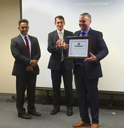 Luis Valadez, Director of Supply Chain Management at HCMC accepts  the 2015 Center of Excellence in Healthcare Purchased Services Award.