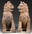 MONUMENTAL PAIR OF CAST IRON BUDDHIST LIONS realized $47,400