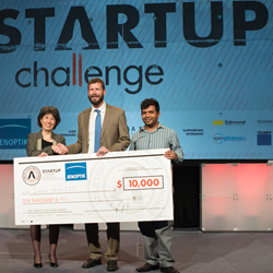 Founding Sponsor Jenoptik representative Jay Kumler, center, congratulates Double Helix on their first-place win in the 2016 SPIE Startup Challenge.