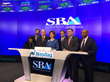 SBA Emerging Business Leader Aziz Ahmad, CEO of UTC Associates, joins Maria Contreras-Sweet, Administrator of SBA and a member of President Obama's cabinet, in NASDAQ closing Bell ceremony.