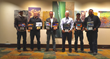 The Southernwind Pools Design Team holds their 8 winning award plaques.