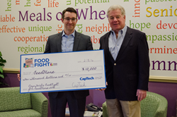 FeedMore CEO Doug Pick receives $10,000 donation from CapTech Principal Dennis Bowne