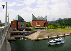 Wide view of the Tennessee Aquarium's two buildings and the River Gorge Explorer