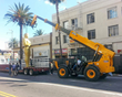 A JCB 512-56 Loadall telescopic handler makes light work of lifting a giant Oscar into place ahead of Sunday's Academy Awards ceremony.