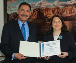 Commissioner Estevan López with Stacy Ann Froelich, P.E., Reclamation's Engineer of the Year.