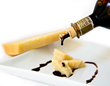 Balsamic vinegar drops on cheese