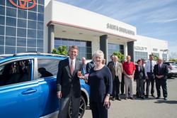Jim Graham, new owner of Santa Margarita Toyota, hands keys of a brand new 2016 Toyota RAV4 to long time commmunity member, Beverly Curtin