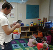 Shown above:  Travis Bauermeister, Amery School District, photo-documents students during an activity