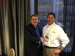 IHRIM Board of Director Kevin Carlson congratulates Keith Goode of ZeroedIn on winning the IHRIM Data Hero Analyst Challenge.