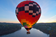 Hot air balloon rides floating over Eagle Ridge Resort & Spa with Galena on the Fly.