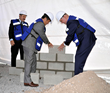 Kunihiko Miyoshi, Chief Regional Officer, Yusen Logistics (Americas), and Jordan Dewart, President, Yusen Logistics (Mexico), lay the foundation stones of the warehouse.