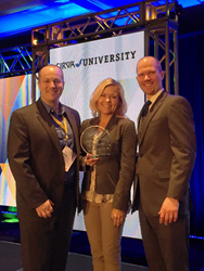 Synergy Global Housing's Executive Vice President, Global Sales, Marketing and Operations, Peter Meyers and Director of Business Development Amy Ramskill pose with  SIRVA's Senior Supply Chain Manager John Kaiser after receiving the 2015 Service Award for