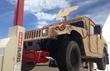 Stertil-Koni lifting Humvee