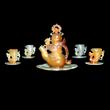 Carved amber tea set.