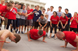 Students from GeorgeTown University participating in Boot Campagin's Pushups for Charity