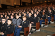 Cadet Brandy Fowler (end seat, row D) in the audience during a presentation at the George C. Marshall Leadership Conference.