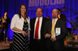 Gretchen Moore, CFO (left) accepts award, along with Manufacturer Rock Shetler (right) of Blazer Industries, Inc.Photo Courtesy: Modular Building Institute