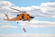 A search and rescue demonstration with a U.S. Coast Guard helicopter in retro color scheme to celebrate the USCG aviation centennial. (USCG photo/Lt. Cmdr. Krystyn Pecora)