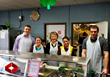 Enclave Development team members serve lunch for the hot meal program, sponsored by the Fargo Salvation Army