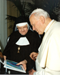 During a May 1,1996 audience in Rome with Pope John Paul II, EWTN Foundress Mother Angelica shared plans for the Network's international expansion with the future saint.