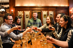 Tourists toasting on a Chicago Beer Experience beer tour.