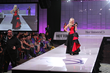 Her Universe Founder and host Ashley Eckstein on the runway from last year's Her Universe Fashion Show. Eckstein returns as host of the 2016 fashion show.