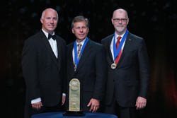 ABC National Chair David Chapin, president of Willmar Electric Service, presents Award to Gilbane's Tony O'Dea, VP Corporate Safety Director and Michael McKelvy, President and CEO