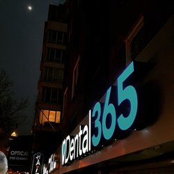 Dental365's storefront at night in Union Square at 24 W. 14th St. New York City