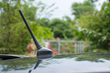 The Fishing Pole Antenna Cover is a decorative invention that adds a unique touch to a vehicle's antenna.