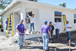 FLPLG and FAPIA work on house for Habitat of Humanity of Broward.