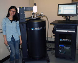 Yue Huang, Brown University postdoctoral research associate, with Lake Shore THz system