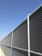 Close up of double chain link fence with Acoustifence application installed by Crown Fence