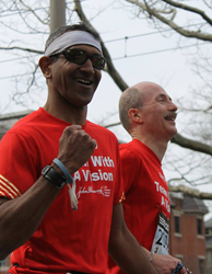 A visually impaired runner and guide compete in Boston Marathon