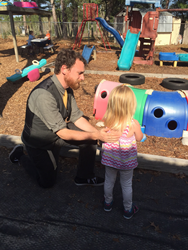 Alex Dissell speaks with one of his students at Little Rascals Daycare