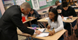 Students work with a JA Volunteer During Financial Literacy Month