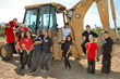 Cochise SDA students surround heavy equipment during groundbreaking for new school.