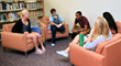 Keiser-University-Flagship-Campus-students-in-library-study-group