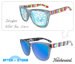 "Jayden's unique design features frosted rainstorm grey fronts, cloud-break blue lenses, and rainbow covered arms on Knockaround's classically styled ""Premiums"" frame style.  Pulling inspiration from Jayden's original drawing, each pair has a small cloud l"